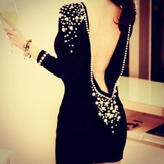 Backless black diamond dress.