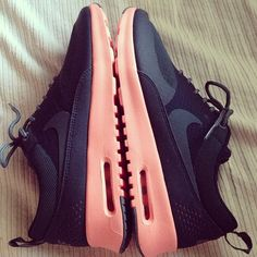 Sleek black with light pink accents. need.