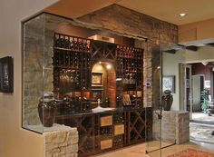 Quaint yet elegant glass encased mini-wine cellar - Buy Wine Crates like these! Visit: www.winepine.com