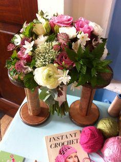 Wedding bouquet from Emma Norton wedding flowers displayed between old sewing spools #styling Www.littleweddinghelper.co.uk