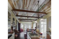 The kitchen of this Spring Island, S.C. home includes reclaimed wood floors from a home in Kentucky and hand-planed walls.