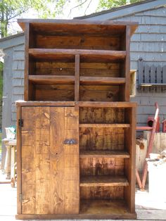 Large handmade rustic cupboard made of old planks.