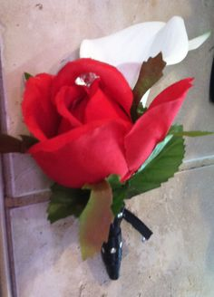Silk rose and calla lily boutonniere with black ribbon and rhinestone wrap