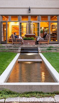 Stunning Water Feature  A narrow course of water centered on the living room wing of the house bisects the backyard. Traditional Home