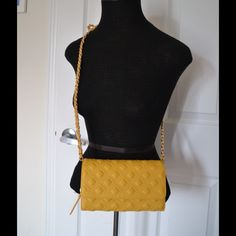 """NWOT Big Buddha cross body bag New never Big Buddha quilted cross body bag. Faux leather & gold toned hardware. Measures 8"""" x 5"""". Shoulder drop 24"""". Three divided compartments, one zip (wallet like). Yellow mustard color. Lovely bag. Big Buddha Bags Crossbody Bags"""