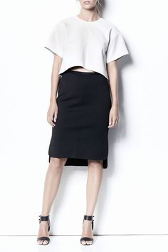 ARIA   TOP  Jewels & Grace   S16     Aria is a drop shoulder, oversized sleeveless top with round neck detail. The Aria features scooped cylinder hem and can be worn two ways. Made using Scuba fabric for a structured fit