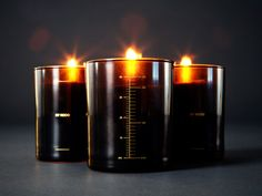 Byredo very first candles still life, gold screen on black glass