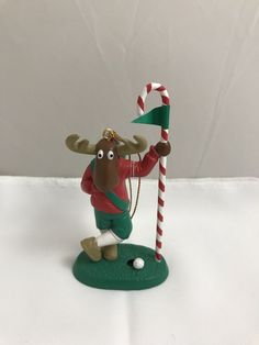 American greetings dora the explorer 2012 christmas ornament new american greetings christmas ornament a stroke of luck reindeer golfer preowned m4hsunfo Image collections