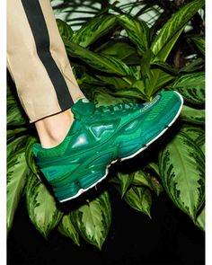 Accented with a lace-up front, these Ozweego 2 sneakers from Adidas By Raf Simons contrast texture and bold color for arresting athletic appeal. Complemented with geometric paneled upper in green leather, these low-tops exude modern cool. Finished with a split sole and lace-up front, this pair features a logo patch at the tongue and ridged rubber sole.
