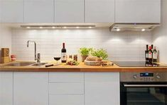 Kitchen: Foxy Modern Small Open Kitchen Galley Decoration Using White LED Lamp Under Cabinet Including Double Bowl Stainless Steel Kitchen Sinks And Oak Wood Butcher Block Kitchen Counter Tops. Decorating Ideas For Kitchens, Pictures Of New Kitchens, Modern Kitchen Designs, Kitchen Ideas Modern, Galley Kitchen Pictures | Oaktreelife - Inspiring Home Interior And Exterior Design Ideas