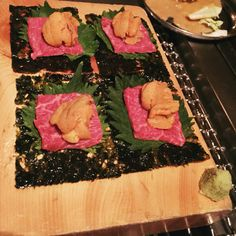 Takashi in the West Village has some of the most exquisite meat dishes the city has to offer. Check out this uni, raw beef delight on top of shiso and seaweed.