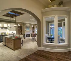 A gorgeous open concept home with a dining room nook and large kitchen. A great example of how to combine hardwood floors and tile on the first floor.