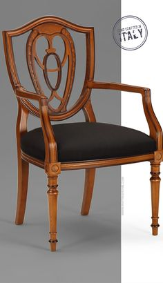 hand-crafted carved wood armchair; hand crafted in Italy; available at InvitingHome.com