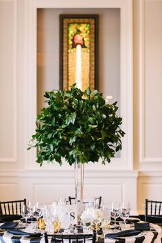 Greenery, green tall centerpiece | T&S Hughes Photography, Chicago History Museum, Revel Decor, Shannon Gail Weddings & Events