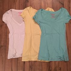 Basic T-Shirt Trio Bundle Gentle use. White v-neck. Pastel blue and yellow crew neck. Each have neon pink stitching. American Eagle Outfitters Tops Tees - Short Sleeve