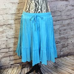 OLD NAVY TURQUOISE COTTON SKIRT Pretty skirt in gently used condition with an elastic and drawstring waist Old Navy Skirts Midi