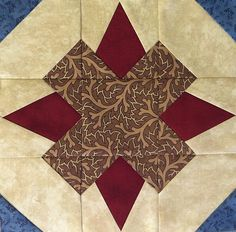 """Block #5 - Pattern is Soldiers Crossing by Deb Eggers of Cottage Rose. Unfinished block is 9 1/2""""."""