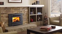At Vaglio in Vancouver. The Alterra contemporary wood insert features a s… - Wood Burning Fireplace Inserts Pellet Stove Fireplace Insert, Wood Burning Fireplace Inserts, Brick Fireplace Makeover, Fireplace Remodel, Fireplace Design, Fireplace Ideas, Fireplace Stone, Modern Fireplace, Fireplace Wall