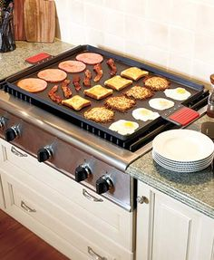 """This Jumbo Griddle makes it easy to cook several different foods at the same time. The spacious surface is ideal for tackling all of your different dishes, especially for big get-togethers. Has handles with silicone grips for easy carrying. 21"""" x 37"""", wi"""
