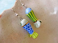 Head for the beach wearing these fun earrings! Hand sculpted earthenware clay fish beads glazed in soft watercolor shades of sea foam green,