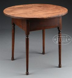 """Second quarter 18th century, New England. The oval pine top projecting above rectangular maple base with molded apron raised on slightly tapered, cylindrical ring-and-bobbin-turned legs on ball feet. SIZE: 27"""" h x 29-1/4"""" l x 25-1/4"""" w. CONDITION: Single board top intact. Glue repair to interior of one leg at juncture of apron. Otherwise very good. 51331-23"""