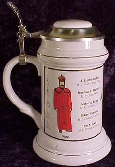 This beautiful Stein was made to commemorate the 200th Anniversary (1795-1995) of Grand Holy Royal Arch Chapter of PA. It is decorated with Red, Blue, and Purple transfers and trimmed in Gold on a white background. It names the Grand Officers and their stations. This stein was made by Stanley C. Buz and is number 363 of a limited edition of 3,000. #freemasonry #grandholyroyalarch