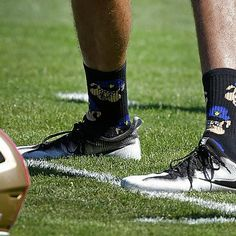 Sports: Colin Kaepernick Criticized for Socks Depicting Police as Pigs