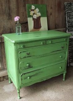 Vintage dresser painted in spring time green and then distressed