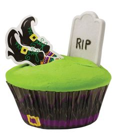 These Almost Buried Tombstone cupcakes from @Wilton Cake Decorating Cake Decorating would be a hit at any Halloween party!
