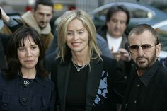 Olivia with Ringo & Barbara attend a photo exhibition of the work of Linda McCartney in London