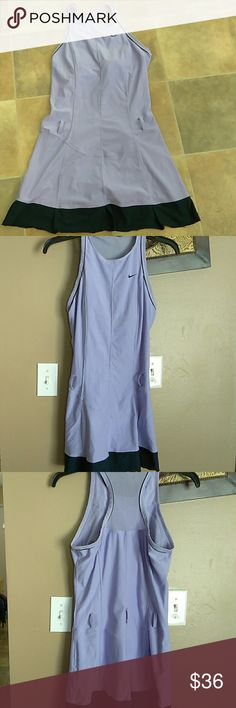 """Nike Dri-Fit Tennis Dress - Small (4-6) The listed beautifullll dress is in good condition and has a built in bra; however, on the back mesh area near the neck area is a faint orange streak (see pic#5) and see last pic where dress has a few faint orange specs. There are 5 belt loops on this dress; however, there is no belt that comes with this.   Approx. Measurements are as follows: Armoit to Armpit 16"""" Waist Across 14.5"""" Shoulder to Hem 32""""  Loc:b2 Nike Dresses"""