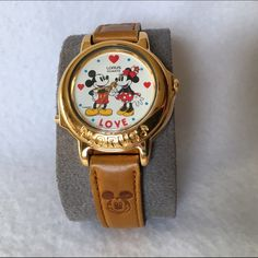 "Musical Mickey Mouse Watch Vintage Mickey and Minnie Mouse watch by Lorus. Plays ""I Wanna Hold Your Hand"" as the watch hands tick around in time with the rhythm of the song. Needs battery. Original leather watch band has embossed Mickey head on each strap. Water resistant. Stainless steel. Collectible. Lorus Accessories Watches"