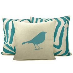 "16"" x 16"" cushion cover with a colorful teal modern bird pattern hand printed on a beige natural linen and cotton blend canvas."