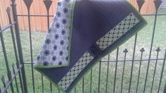 Front of green and grey baby quilt.