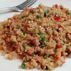 Pork Fried Quinoa - Allrecipes.com Modifications: fry garlic with onions, remove peppers, add carrots and peas, add sesame oil, no spice!