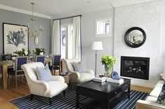 Kerrisdale Design - living rooms - 6 Light Marigot Chandelier, black coffee table, coffee table ideas, blue quartz, tan sofa, floor to ceili...