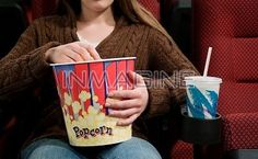 ... About (crb415) > Girl in Movie Theater Eating Popcorn ( crb415031