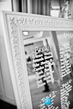 Love this... seating plan written on mirror. Can also be done on nice paper and framed. Beats seating cards that are just going to get tossed!