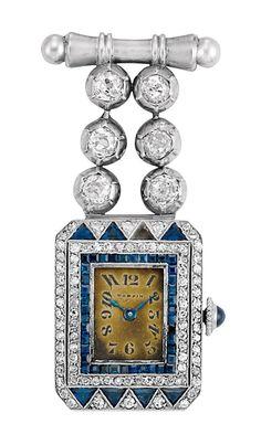 An Art Deco Platinum, White Gold, Diamond and Sapphire Lapel Watch, Mappin. 6 diamonds ap. .80 ct., dial signed Mappin, c. 1920. #ArtDeco #Mappin #watch