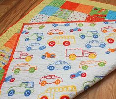 I have that fabric... I didn't want to rip it into strips for a rug... and wanted to make a quilt out of it like this!