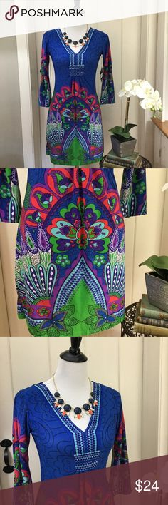 """NWT WHITE MARK Couture Collection Blue Shift Dress NWT royal blue v-neck shift dress with 3/4 length bell sleeves and a colorful swirling paisley print. In brand new condition with no holes, no spots, no rips, no defects. A gorgeous slip-on dress with stretch. Chest 15"""", length 32"""". White Mark Dresses"""