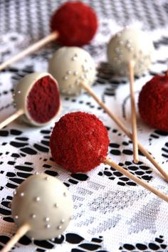 red velvet cake pops- Made for my wedding. Super yummy!!! Had to dip white twice to cover red.