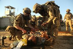 British soldiers strap a U.S. soldier to a litter during a medical evacuation simulation as part of the Swift Response 16 training exercise at Hohenfels Training Area in Hohenfels, Germany, Jun. 23, 2016. More than 5,000 service members from 10 countries are participating in the exercise. Following yesterday's historic decision by voters in the United Kingdom to withdraw from the European Union, Defense Secretary Ash Carter spoke by telephone June 24 with his U.K. counterpart, Defense…