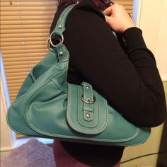 Light blue thick pleather handbag NWT handbag. Brand new handbag. Lots of room inside and great lined interior. Feels like  leather but it's pleather. Magnetic clasp. Bags Shoulder Bags