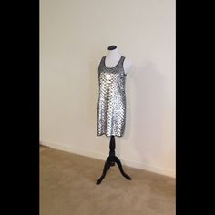 Michael Kors Black and silver dress Black dress has silver sequin throughout in snake skin pattern. Michael Kors Dresses Midi