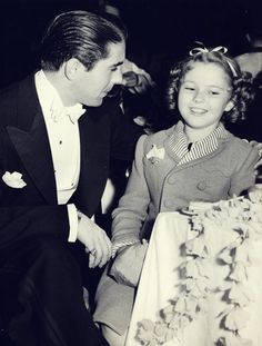Shirley Temple with Tyrone Power at the Academy Awards, 1939.