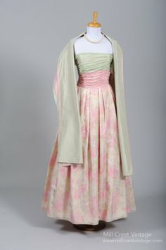 Ball Gown: 1970's, silk taffeta blend in the bodice and a floral damask cotton blend in the skirt over a pink cotton blend lining.
