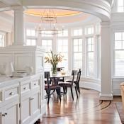 The angular coffered ceiling of the kitchen contrasts with the oval shape of the adjacent breakfast room. Beautiful.