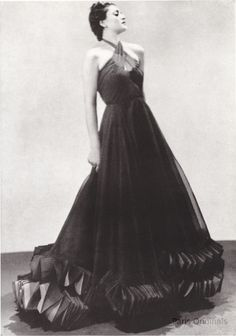 Man Ray for Harper's Bazaar 1937  Gown made with 81 yards or purple Mousseline  with ruching in green and purple on the bottom