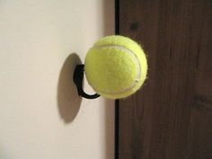 Closet Organizing Tip - Tennis ball on the hook to keep shirts and sweaters from getting the hook mark.  This whole closet is great.